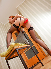 Nymph redhead coed posing in black stockings and toying herself