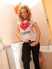A teenage cutie pleasuring herself in the bathroom