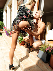 Lush blonde Katrin Tequila peels off her miniskirt dress and gives her lover a stiffie ride in her creamy bald pussy