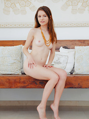 Sofi Shane shows off her creamy, petite body and pink pussy on the chair.
