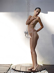 Skinny girl washing her young body