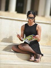 Amazing brunette babe showing her black stockings