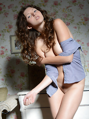 Remarkable dark haired girl with alluring tits taking off clothes and showing hot body.