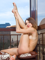 Susana exhibits her acrobatic skills and flexible, athletic body in a stunning studio photo shoot.