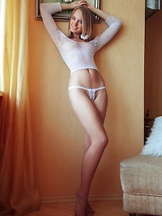 With her bright blue eyes sparkling like two precious gems and pearly white smile, Rachel looks exquisite in a white fishnet top and matching panties that accentuates her gorgeous body curves perfectly.
