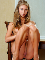 Skinny girl from Russia shows shaved pussy