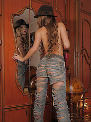 Milena exudes a sultry, foxy, and mysterious babe in fedora hat, tattered jeans, and black suspenders.