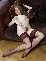 Brown-haired Kristel shows her hairy hole