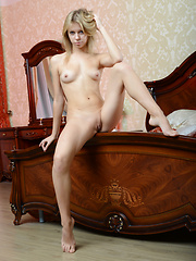 Wonderful bombshell with a tattoo on her right arm demonstrating naughty quim on the bed.