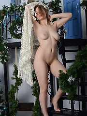 Enchanting slender hottie with incredible hooters and vicious look posing absolutely naked.