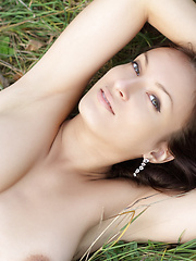 Admirable dark haired sweetie with perfect breasts flaunting shaved quim on the nature.