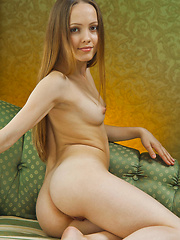 Nelly loves lounging around the sofa, naked most of the time, parading her stunningly firm body.