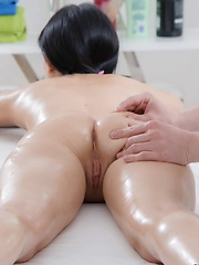 Fantastic brunette babe fucked by her masseur