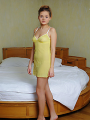 Young and innocent Colleen A in a sheer yellow lingerie dress