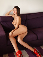 Sunshine A posing naked in her red hot stiletto heels.