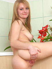Busty Nubile with a perfect ass spreads open her sweet snatch