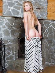 A charming Daisy lifts the hem of her polka-dotted skirt, showing off her smooth legs, cute round butt, and pink snatch.