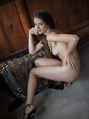 Sultry seductress Loretta A showcases her stunning tight body with ever-erect breasts, slim waist, and long, svelte legs.