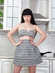 Tayra Jane strips in her kitchen to show off body