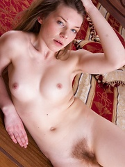 Amber S undresses across her red bed seductively